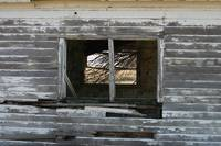Old wooden building broken out window
