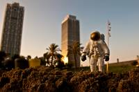 Astronaut walking in Barceloneta Beach, ES