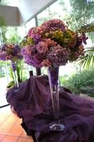 An image of flower arrangements for a wedding