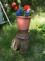 Old milk can with flowers