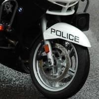 Police Motorcycle Tire by John Tribolet