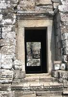 ankor wat face through the corridor
