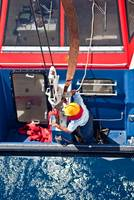 Re-stowing lifeboat after return as ship-to-shore