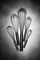Kitchen Whisks on steel black and white photograph