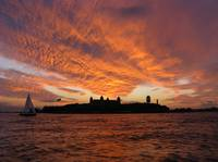 Sunset with Sailboat at Ellis Island
