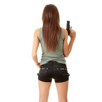 Young caucasian woman with gun