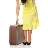 Caucasian woman legs with travel case.