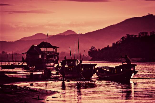 Boats on the banks of the Mekong in Laos
