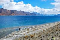 TOURISTS AT PANGONG TSO HIGH ALTITUDE LAKE LEH LAD