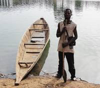 The Road to Bamako via dugout canoe