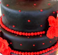 Black and red fondant icing cake