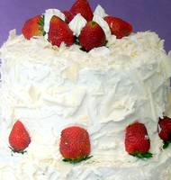 Romantic white cream cake with red strawberries