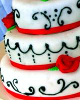 White wedding cake with red trim