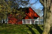 Red Barn and White Horse Fence