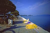 Seafront with Yellow Nets, Island of Hydra, Greece by Priscilla Turner