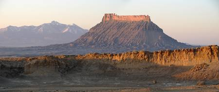 Factory Butte with the Henry Mountains