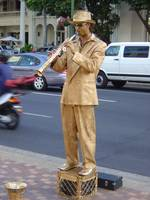 Living Statue Blows His Horn