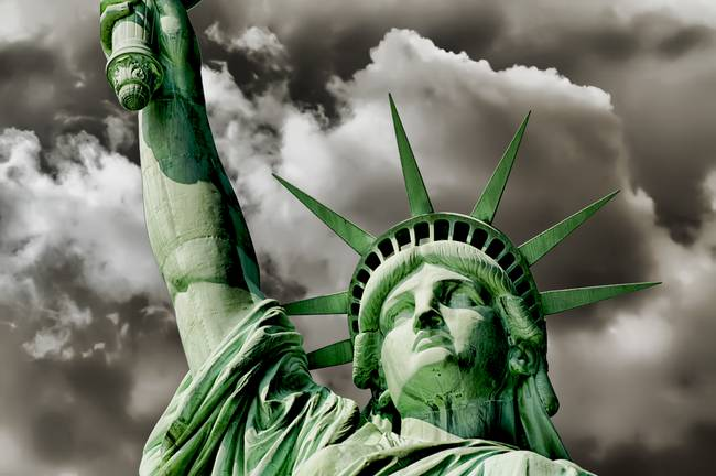 Lady Liberty braces against a turbulent sky Poster