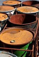 Old rusty waste barrels.