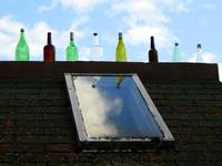 Bottles adorning the eaves of the Bottle House, Pr