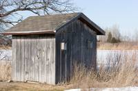 Old Weathered Board and Batten Shed with Birdhouse
