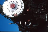 Posed beside an 1880 steam locomotive