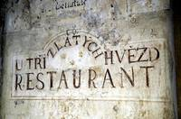 An old restaurant sign in Prague.