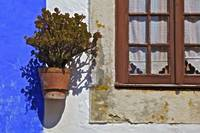 Rustic Window on a Plaster Blue and White Wall