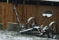 Snow-covered old farm equipment