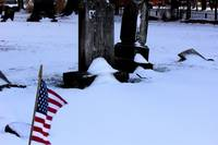 Old Cemetery stones with flag in the foreground.