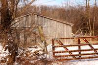 Run down barn in a wintry scene