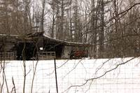 Rustic shed in a winter scene