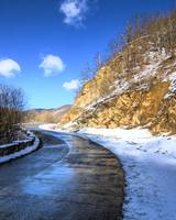 Frozen road in the mountains with snow