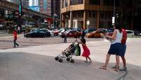 Lil Girl In Red Pushes Pram
