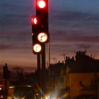red traffic light by Louise Dionne
