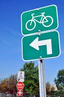 Bicycles turn left sign.