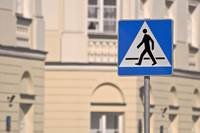 Pedestrian crossing sign.