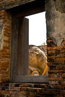 Reclining Buddha, view through a window