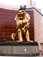 macau lion with workers