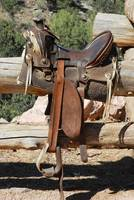 Saddle on Ranch Fence
