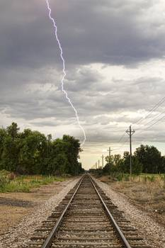lightning striking by the train tracks by james bo insogna