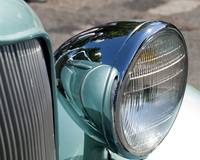 reflections in headlamp of 33 plymouth