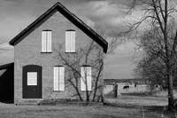 Brick House With White Shutters BW