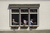 People Sit by Windows in Small Town America Even W