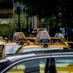 Cabs in Manhattan by James Howe