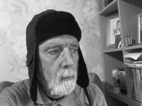 MAN IN RUSSIAN HAT IN B&W