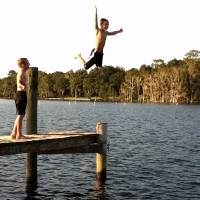 Carson Jump Two Boys on Dock by Barbara Wilford Gentry