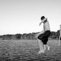 Three Boys Jump in Water Black and White by Barbara Wilford Gentry
