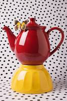Red teapot with butterfly