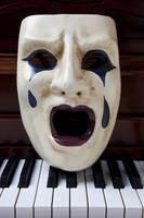 Crying mask on piano keys